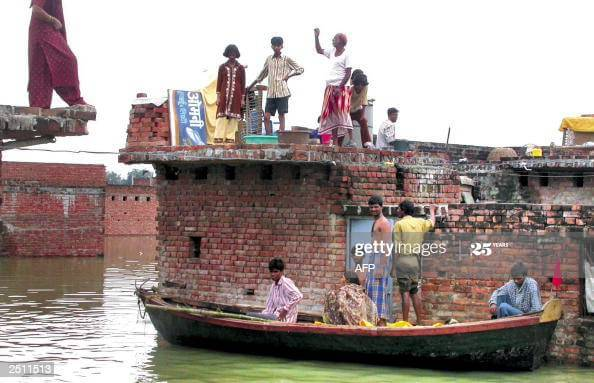 People climed at top of their roof in Bihar flood